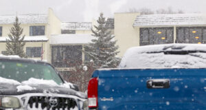 An image of snow falling from Winter Storm John in the Village area at Bolton Valley Ski Resort in Vermont