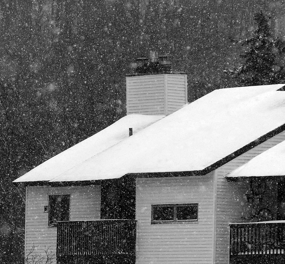 An image of some condominiums with snow falling from Winter Storm John at Bolton Valley Ski Resort in Vermont