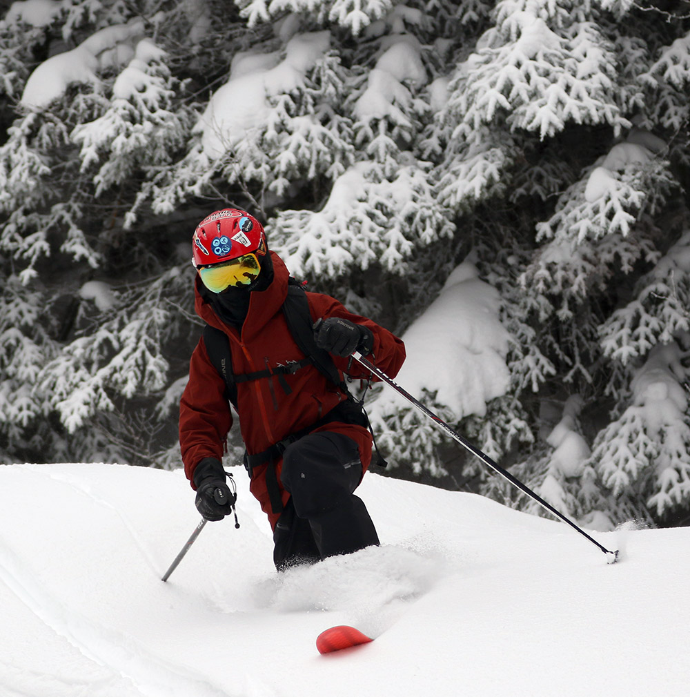 An image of Dylan Telemark skiing in powder from Winter Storm John at Bolton Valley Resort in Vermont