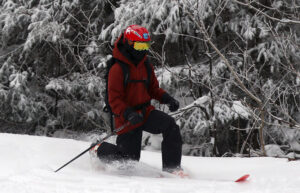 An image of Dylan Telemark skiing in powder from Winter Storm John while ski touring in the Wilderness area at Bolton Valley Resort in Vermont
