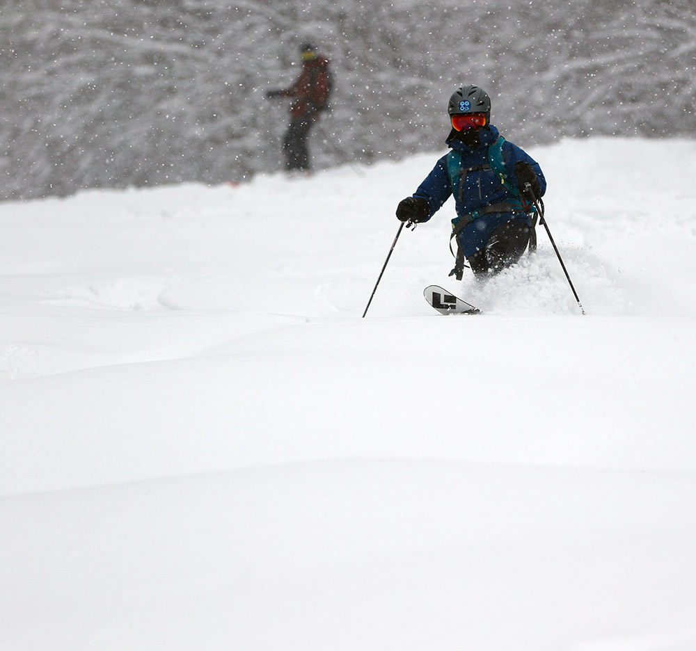 An image of Erica skiing on the Twice as Nice Trail during Winter Storm Malcolm at the Timberline area of Bolton Valley Ski Resort in Vermont