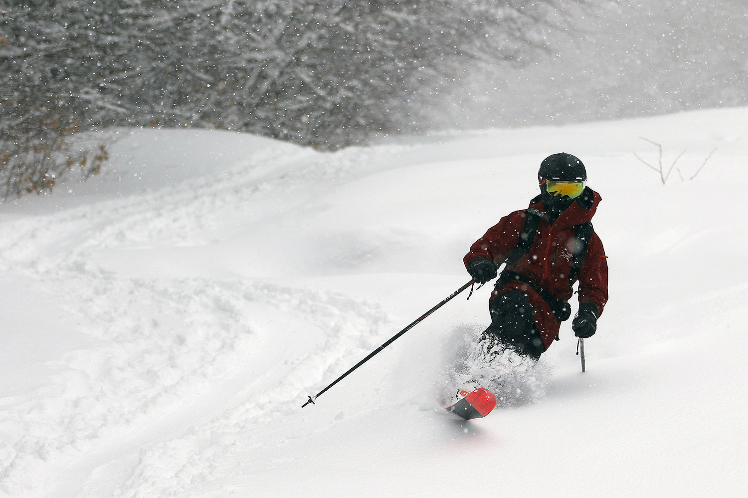 An image of Dylan Telemark skiing in fresh powder from Winter Storm Malcolm while we wait for the Timberline Quad chair to start loading at Bolton Valley Ski Resort in Vermont