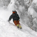 An image of Ty skiing through fresh snow from Winter Storm Malcolm on the Hard Luck trail at Bolton Valley Ski Resort in Vermont