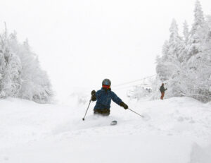 An image of Erica skiing the Hard Luck trail in snow from Winter Storm Malcolm at Bolton Valley Ski Resort in Vermont