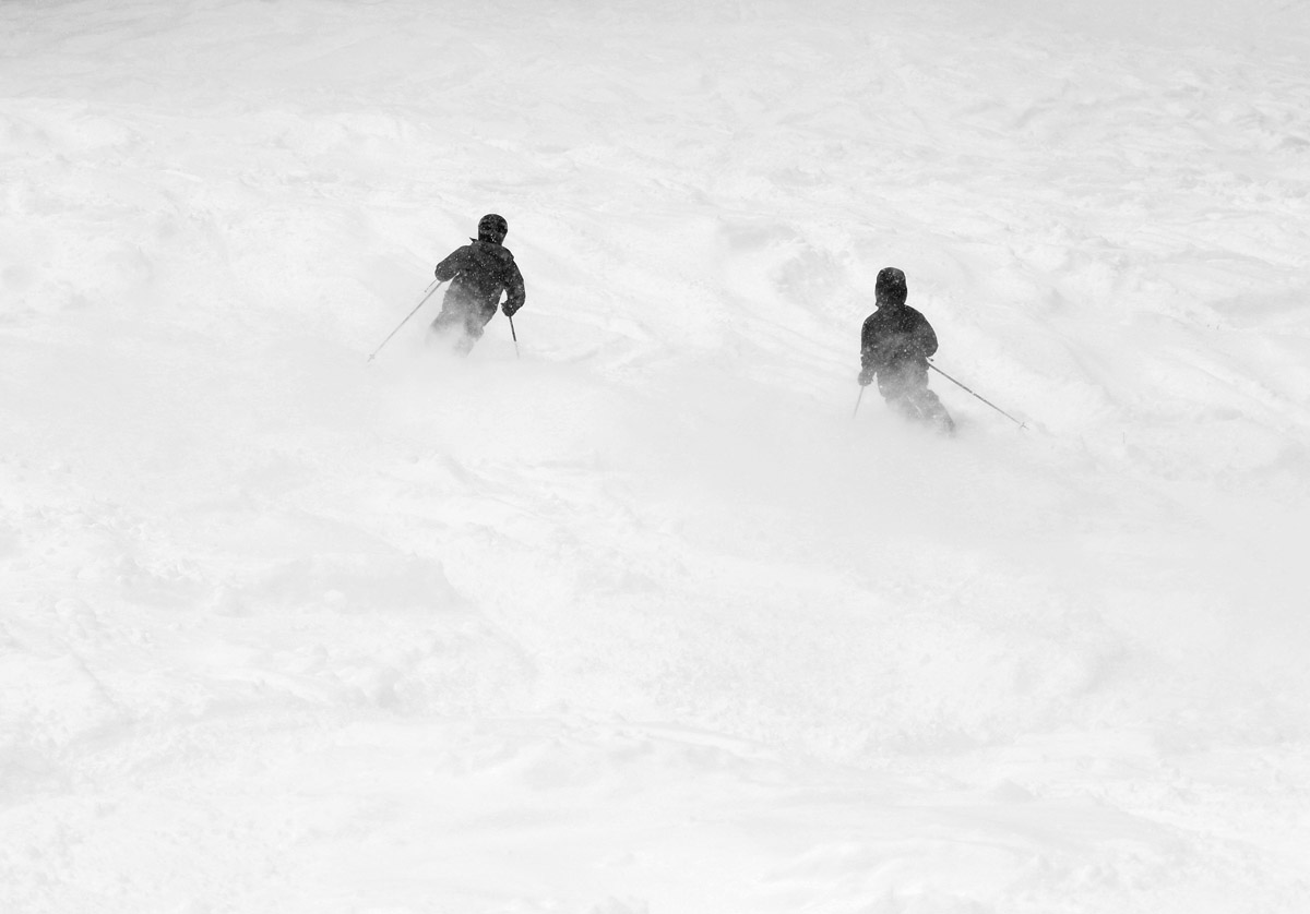 An image of Ty and Dylan skiing powder snow left by upslope precipitation during a January storm at Bolton Valley Ski Resort in Vermont