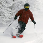 An image of Dylan skiing powder during a January snowstorm at Bolton Valley Resort in Vermont