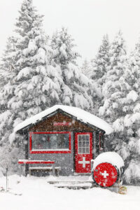 An image of the ski patrol hut at the Timberline Summit area during some heavy morning snowfall at Bolton Valley Ski Resort in Vermont