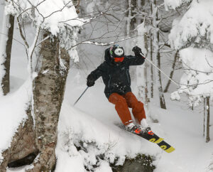 An image of Ty skiing trees in the Timberline area of Bolton Valley Resort in Vermont during a January snowstorm