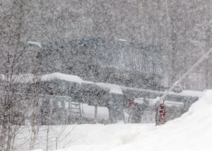 An image of the base station of the Timberline Quad Chairlift through heavy snowfall on the back side of Winter Storm Nathaniel in January at Bolton Valley Ski Resort in Vermont