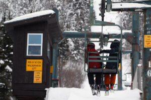 An image of Ty and Dylan approaching the mid station area of the Wilderness Double Chair at Bolton Valley Ski Resort in Vermont