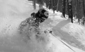 An image of Ty skiing through powder after Winter Storm Roland in the Doug's Solitude area of Bolton Valley Ski Resort in Vermont