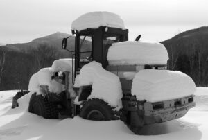 An image of a bucket loader covered with snow on a ski tour of the Nordic and Backcountry trail network at Bolton Valley Ski Resort in Vermont