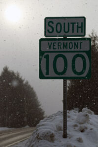 An image of a road sign for Route 100 in Vermont during a bout of February snow