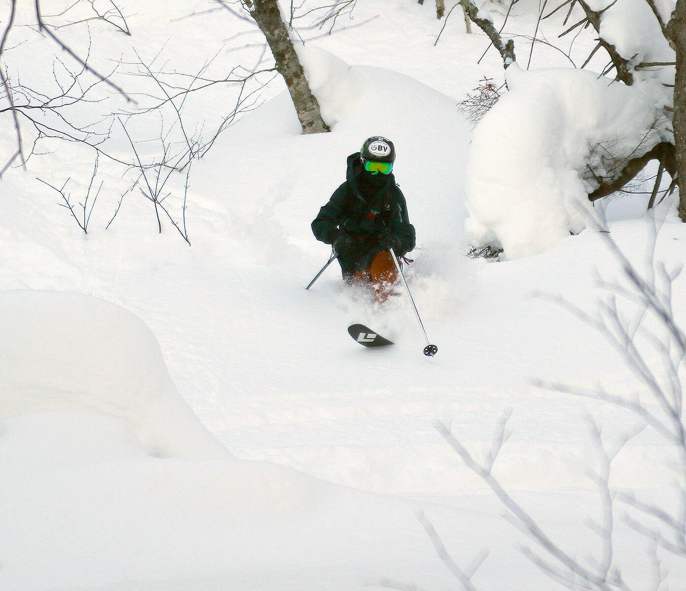 An image of Ty Telemark skiing in deep powder from Winter Storm Viola in the Big Jay Basin backcountry near Jay Peak Resort in Vermont