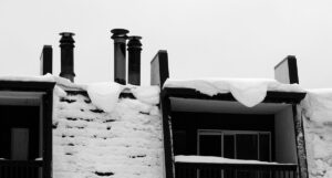 An image of snow on the roof of the hotel in the Village at Bolton Valley Ski Resort in Vermont