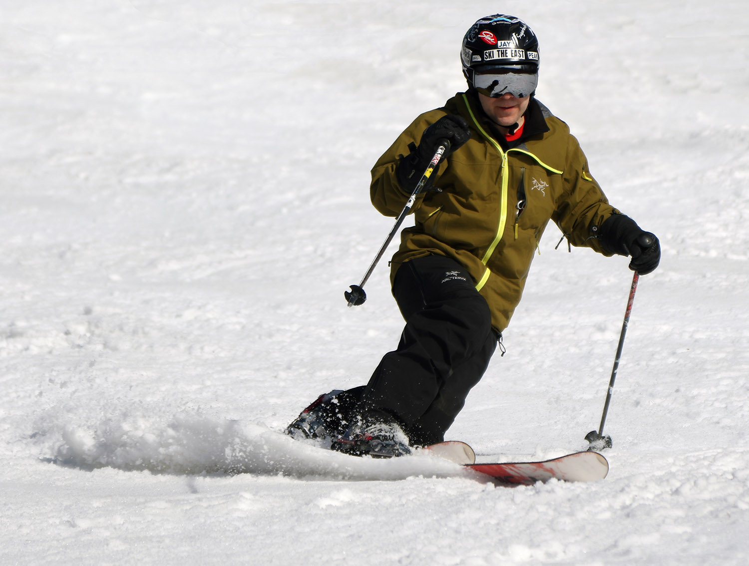 An image of Jay Telemark skiing in spring snow on the Showtime trail at Bolton Valley Ski Resort in Vermont