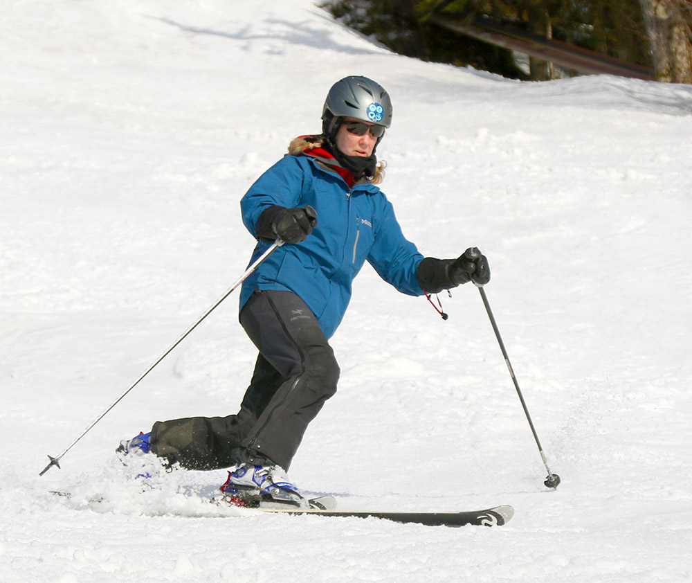 An image of Erica Telemark skiing in spring snow in March at Bolton Valley Ski Resort in Vermont