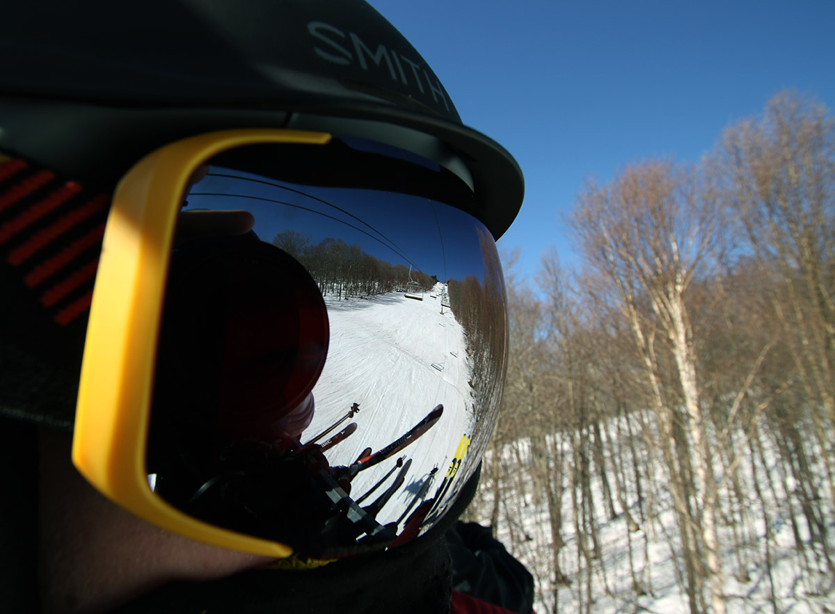 An image of a ski trail off reflective goggles while on the Timberline Quad Chairlift at Bolton Valley Ski Resort in Vermont
