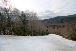 An image showing part of the Hard Luck ski trail on an April day at Bolton Valley Ski Resort in Vermont
