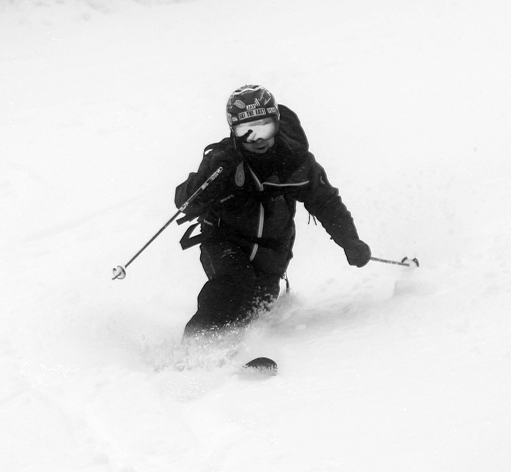 An image of Jay Telemark skiing in 18 inches of new snow that fell from an April snowstorm at Pico Mountain Ski Resort in Vermont