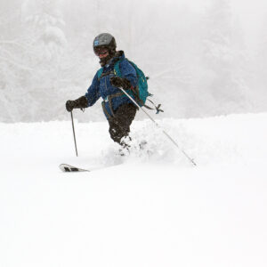 An image of Erica Telemark skiing in snow from an April snowstorm at Pico Mountain Ski Resort in Vermont