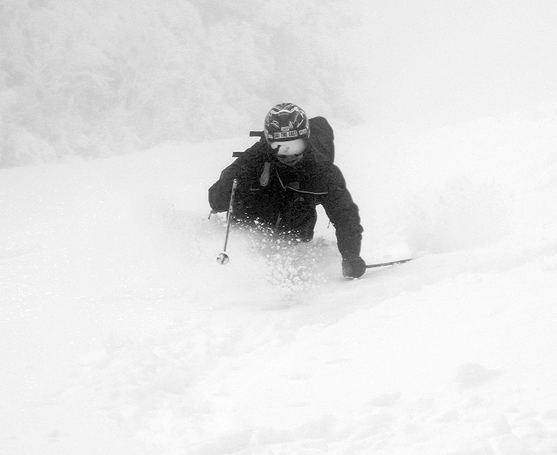 An imager of Jay Telemark skiing in some deep powder after an April snowstorm at Pico Mountain Ski Resort in Vermont