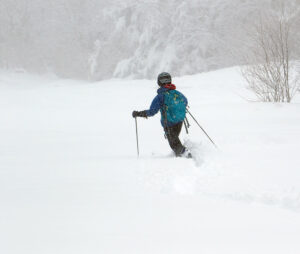 An image of Erica skiing some powder on the lower mountain after an April snowstorm at Pico Mountain Ski Resort in Vermont